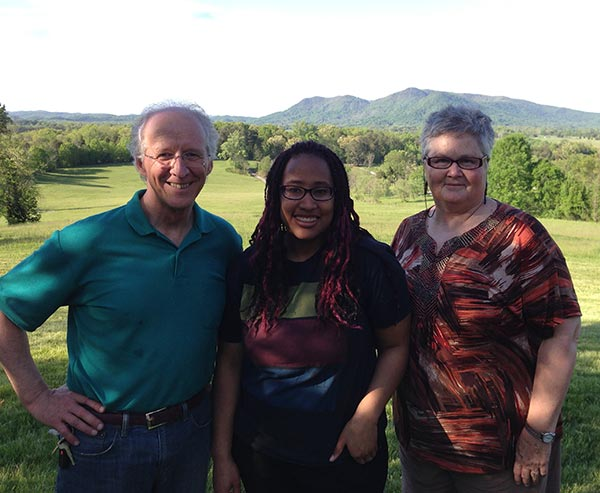 Family photo of John, Talitha, and Noel Piper with mountains in the background
